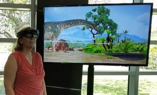 Dr. Brown wearing the Microsoft HoloLens to view a prehistoric environment in 3d