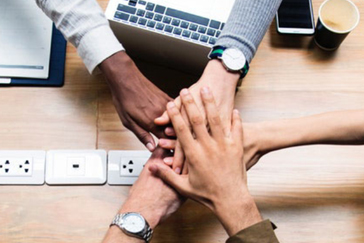 office team hands together